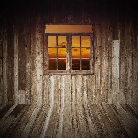 wooden room with a window overlook the sky photo