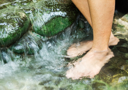 soak: Soak your feet in hot springs to relax.