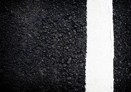 white line on the road texture background photo