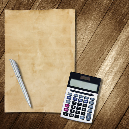 stationery office equipment and paper on wooden background photo