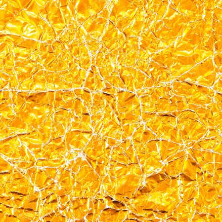 shiny background: Shiny yellow leaf gold foil texture background