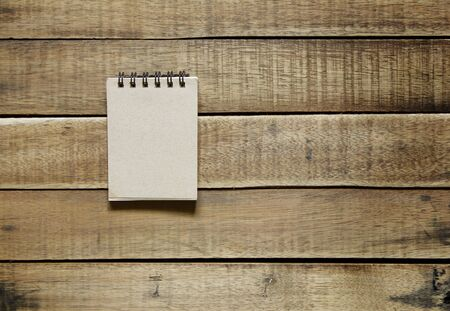 notepaper on wood, stationery office equipment  on wooden background.