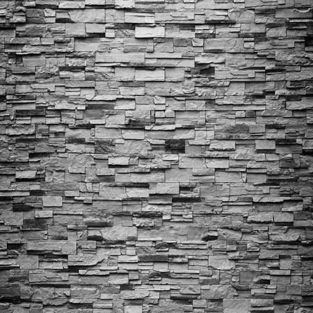 texture of the stone wall for background. Banco de Imagens