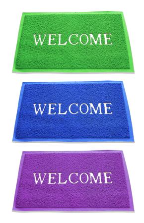 doormat: doormat of welcome text on white background. Stock Photo