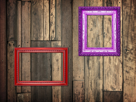 frame on wooden wall background.