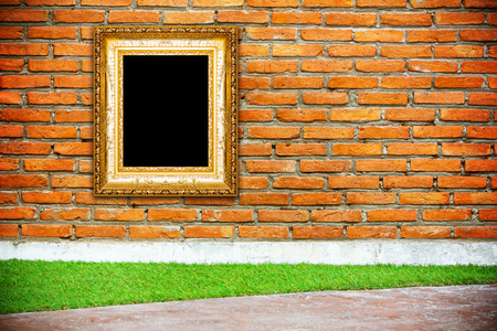 antique gold frame: Antique gold frame on brick wall background Stock Photo