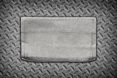 jeans labels on steel plate background.