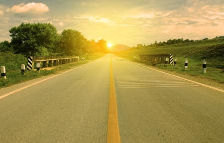 Picturesque landscape scene and sunrise above road. Stock Photo