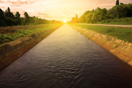 sunrise and Isunrise and Irrigation canal in the rainy season ,Northern in thailand