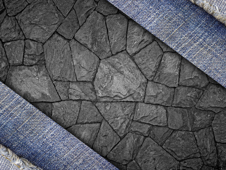 Background from a jeans fabric on stone wall.
