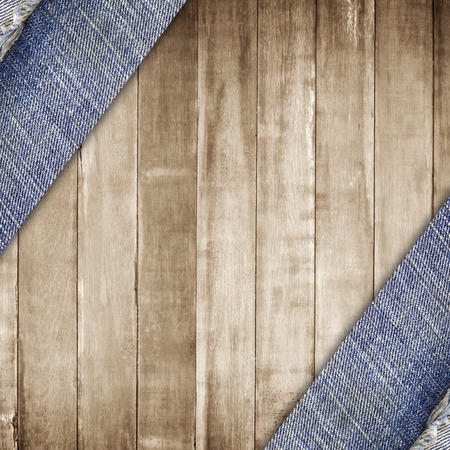 jeans fabric on wooden wall background or texture.