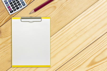 notepaper and pencil on wooden background. Stock Photo