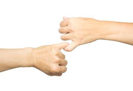 Female and male hands reconcile with clasping each others little finger isolated on white, concept of promise