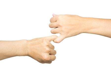Weibliche und männliche Hände versöhnen mit umklammern einander den kleinen Finger isoliert auf weiß, Konzept der Versprechen Standard-Bild - 84186203