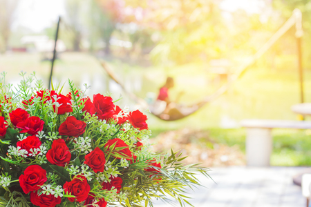Red roses, Concept of relaxation in the garden.