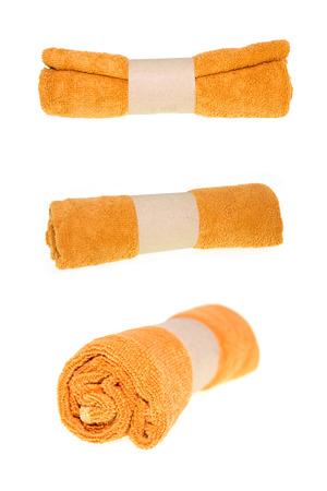 Orange soft towel rolled up on white background.