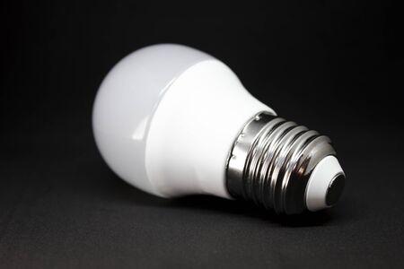 LED lamp on dark background. LED bulb on black background.