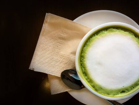 Hot green tea in a white glass in a coffee shop. Stock Photo