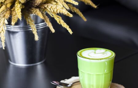 Hot green tea latte with green on wooden. Stock Photo