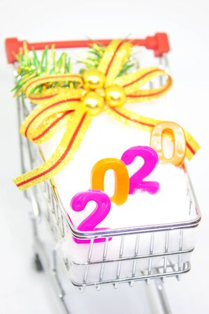 Happy New Year 2020. symbol from number 2020 in Basket cart on white background. Stock Photo