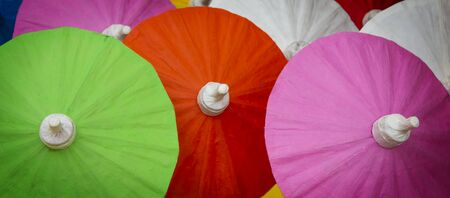 Colorful umbrellas for background texture, umbrellas  at street market in Thailand. Stock Photo
