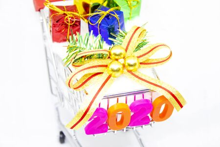 Happy New Year 2020. symbol from number 2020 and gift box in Basket cart on white background.
