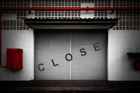 Close factory door by announcing the termination of the factory due to the economic crisis and the recession from unemployment andsituation of Covid 19.