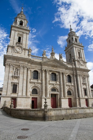 Facade of the Cathedral of Lugo with two towers with blue sky background with clouds  Galicia  Spain  photo