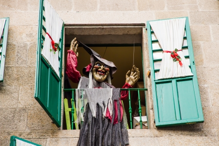 Window decorated home for the holidays witch puppet  lugo  Galicia  Spain photo