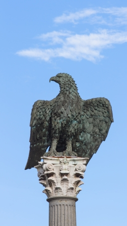 thousandth: Sculpture in bronze imperial eagle with open wings granite column stone spire and Corinthian  It commemorates the two thousandth anniversary of the city of Lugo  Galicia  Spain