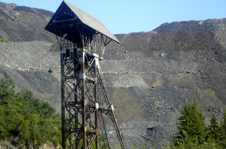open pit: Thatched Tower Minehead old unused  Fonde landscape of current open pit mine Stock Photo