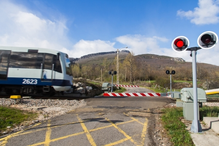 Traffic signs and barriers Level Crossing Road  Crossing via rail and road with street lamps in mountain area