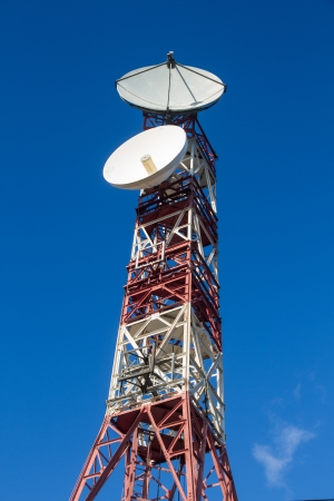 telecommunications tower or metal tower with satellite dishes transmit and receive