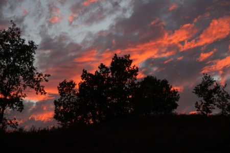 Beautiful sunset at dusk in summer  Oak hill landscape  Heaven with fire reds and grays photo
