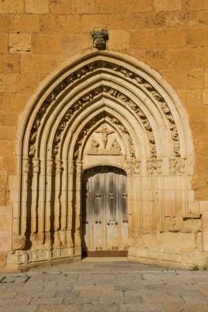 Lintel of the west gate of the Monastery of Sandoval, decorated with figures  Christ, Virgin and child, praying monk kneeling  and floral motifs carved in stone  Monastery, Cistercian of the twelfth century Santa Maria de Sandoval  Leon  Spain photo