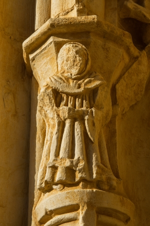 friar: Figure sculptural monk or friar, carved in stone, situated in the arches of one of the gates of the monastery of the twelfth century Cistercian, Santa Mar�a de Sandoval  Leon  Spain