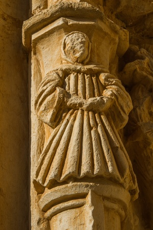 deteriorated: Figure sculptural monk or friar, carved in stone, situated in the arches of one of the gates of the monastery of the twelfth century Cistercian, Santa Mar�a de Sandoval  Leon  Spain