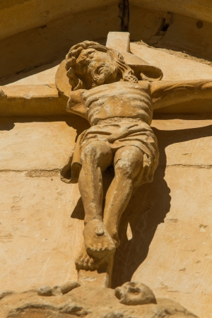 lintel: Central sculptural figure of Christ with outstretched arms, carved in stone, located on the lintel of a door of the monastery of the twelfth century Cistercian, Santa Mar�a de Sandoval  Leon  Spain