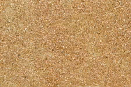 earthy: Texture or background wall ocher adobe  mud mixed with straw baked in the sun