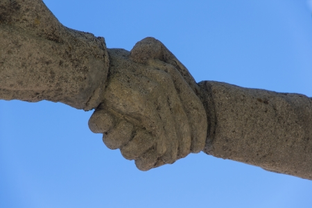 Detail of monument to livestock Bonar Spain   Hand giving himself -  Closing a deal