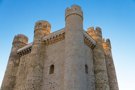 battlements: Towers and battlements of Castillo de Valencia de Don Juan with warm light of sunset   Coyanza   Spain Editorial