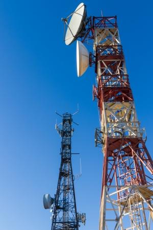 Metal tower or turret telecommunications satellite dishes reception and emission  Reklamní fotografie