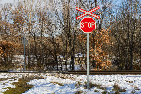 Stop sign at level crossing without barriers via train
