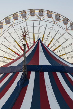 Circus Tent and cone Ferris wheel in the background photo