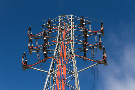 Top of tower with power line insulators  Stock Photo