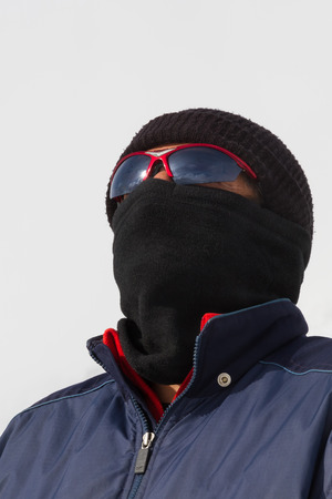 camouflaged: Camouflaged man with sunglasses and balaclava