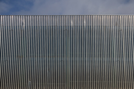 building sector: Structure and linear geometry of metal silver gray lining building facade  Stock Photo