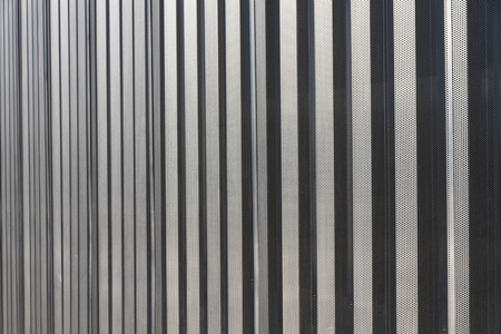 drilled: Linear geometric background or texture silvery gray color  Metal structure covered car park facade