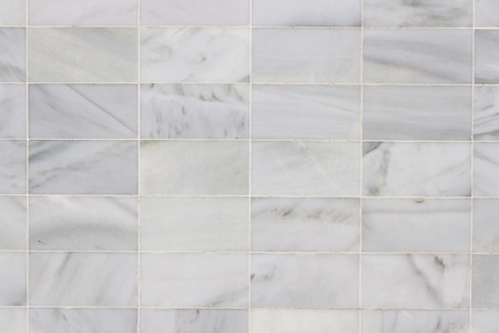 Checkered background or textured wall with stone slabs of gray and white marble  Stock Photo