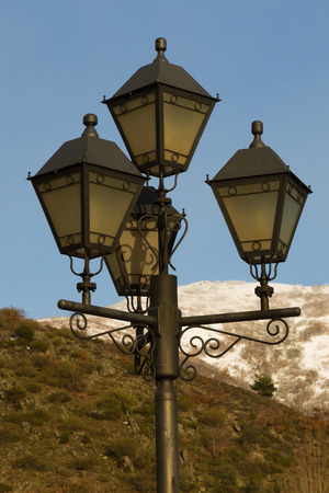 Streetlights to classic or old style mountain area in winter at sunset  Stock Photo - 29307022